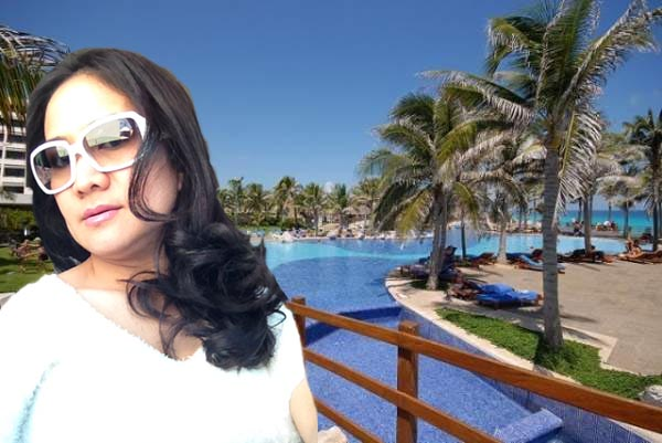 Hispanic woman in Cancun swimming pool