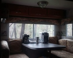 Interior view of RV Dining area..Table lowers to make an additional sleeping area.
